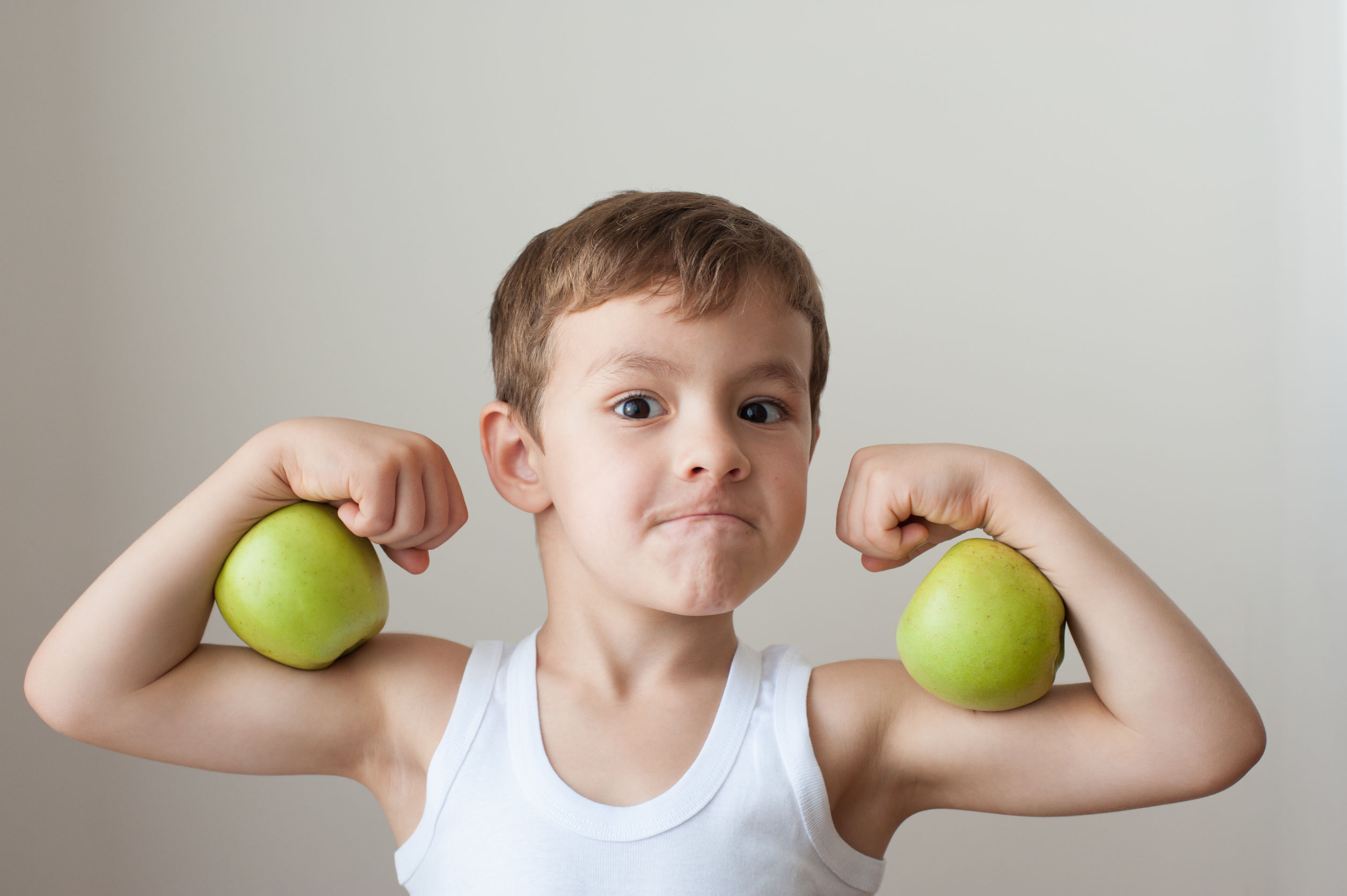 Boy With Apples Show Biceps